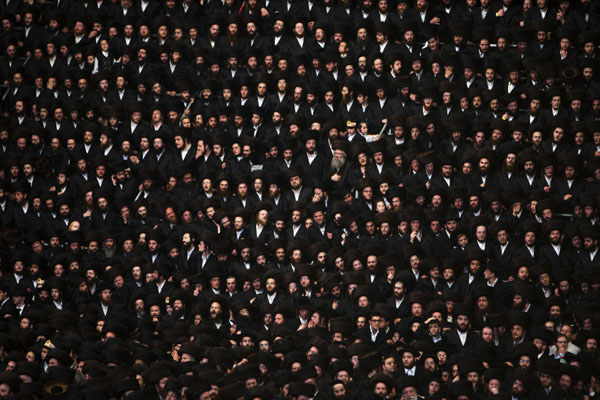 Ultra-Orthodox Jewish men attend the wedding ceremony of Rokeach the grandson of the Chief Rabbi of Belz in Jerusalem